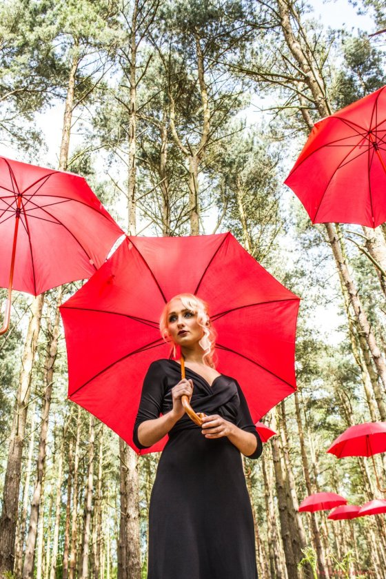 Toni with red umbrellas