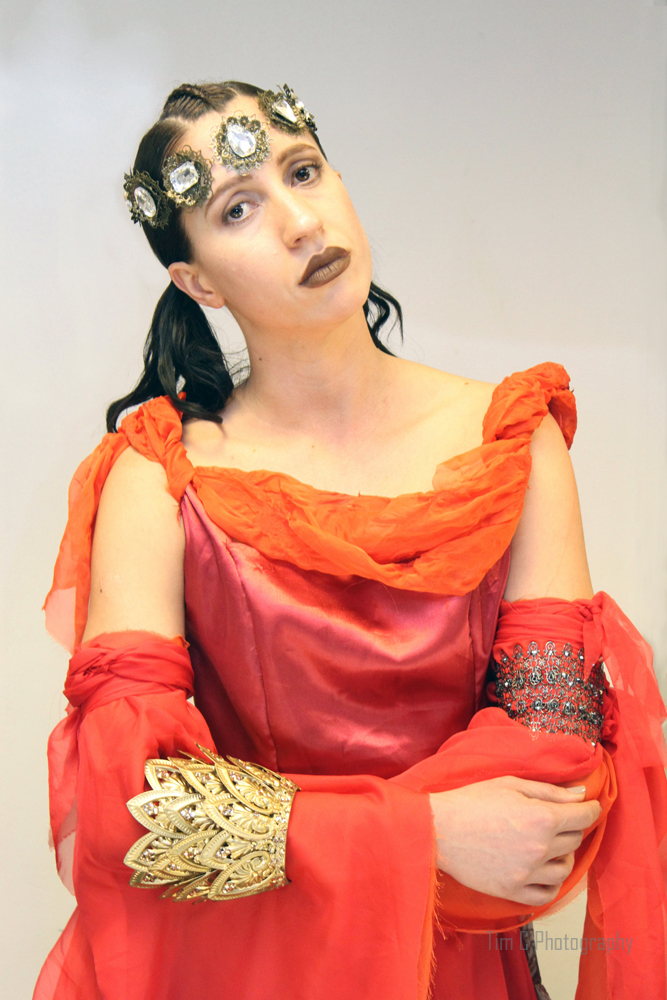 Dress designer Linda Blissett. Headwear and Accessory designer Marianna Harutunian US fashion source. Model Danubia Sousa.
