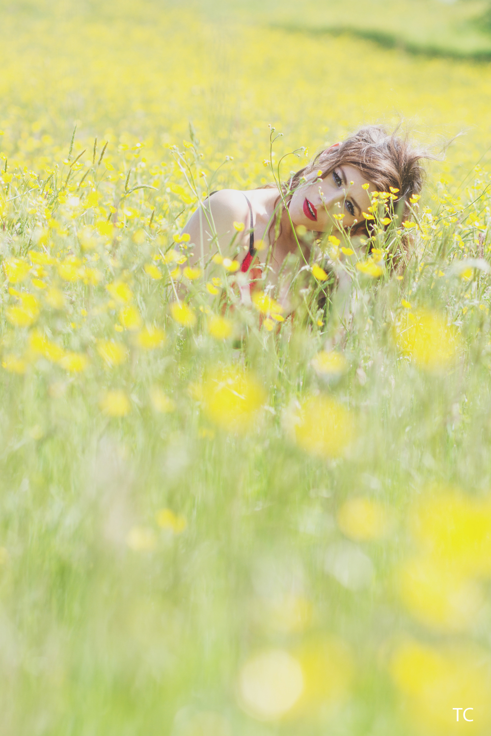 Portrait of Carla in a field of buttercups